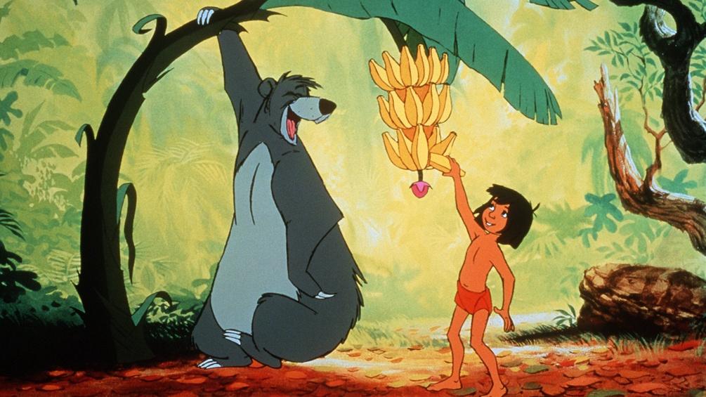 """Filmstill aus """"Walt Disneys Dschungelbuch"""" mit Balu und Mogli"""