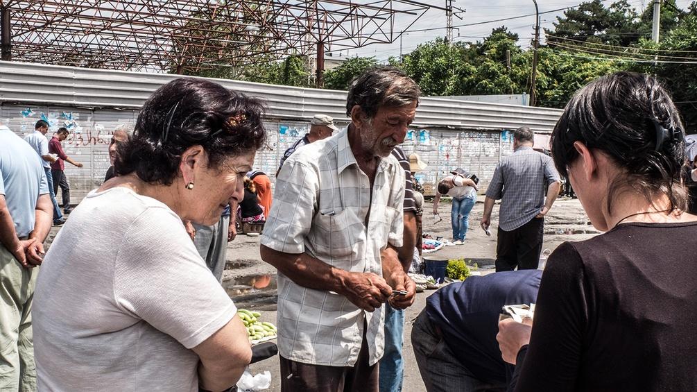 Menschen am Markt