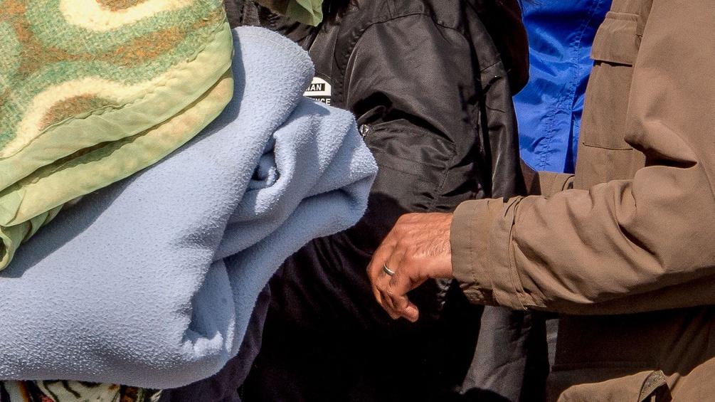 Flüchtlinge mit Decken