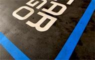 Carsharing-Markierung am Boden einer Garage