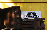 Baucontainer mit Alpine-Logo